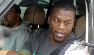 ASSOCIATED PRESS PHOTOGRAPHS Left: Cleveland Browns tight end Benjamin Watson talks to reporters as he and punter Reggie Hodges arrive at the team's headquarters in Berea, Ohio, on Tuesday. Right: Browns president Mike Holmgren arrives at the Berea facility.