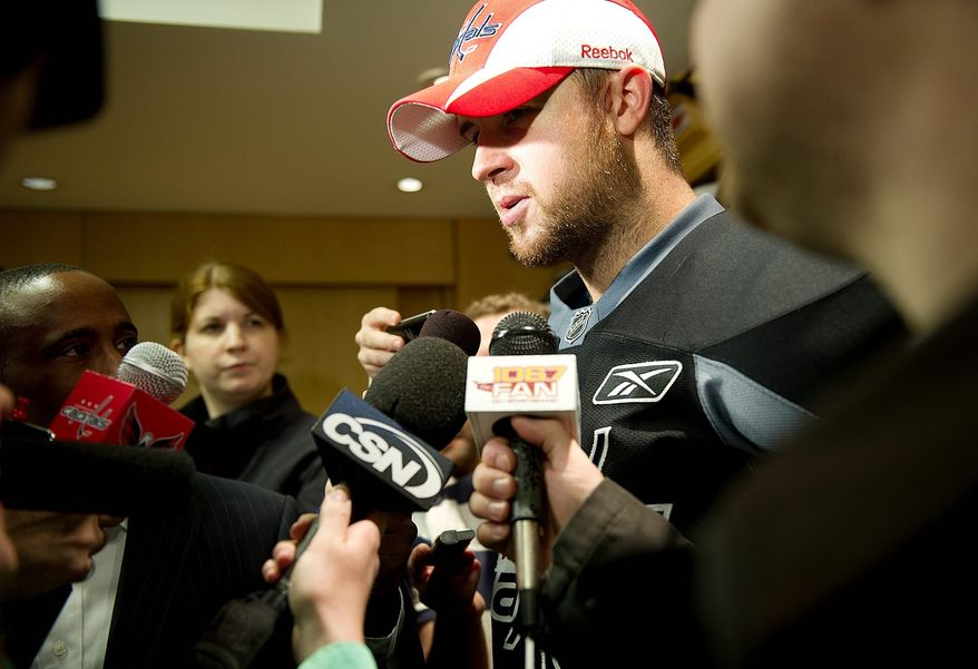 Mike Green talks to the media following the Washington Capitals practice Tuesday, April 26, 2011 at the Kettler Capitals Iceplex in Arlington, Va., in preparation for the next round of the playoffs. (Barbara L. Salisbury/The Washington Times)
