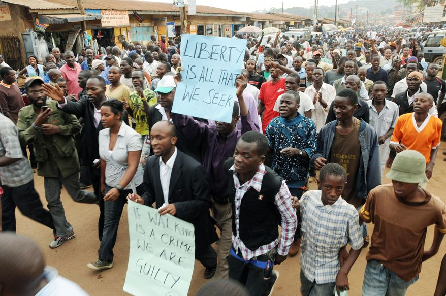 Associated Press photographs Ugandans march in Kampala in an April 21 demonstration sparked by the arrest of opposition leader Kizza Besigye.