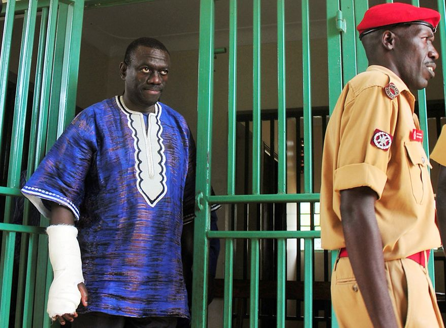 Three-time Ugandan presidential candidate Kizza Besigye leaves Chief Magistrates Court in Nakasongola, Uganda, on Wednesday upon being granted bail.