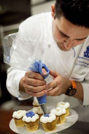 ** FILE ** Daniel Mangione, a chef at the Ritz-Carlton in Georgetown, prepares cupcakes. (NICHOLAS GINGOLD/SPECIAL TO THE WASHINGTON TIMES)