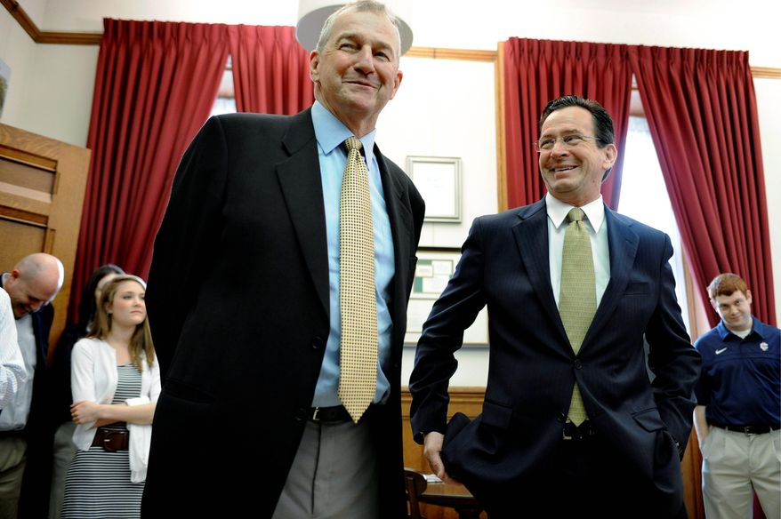 Connecticut basketball coach Jim Calhoun (left), shown with Connecticut Gov. Dannel P. Malloy, has a financial stake in his team's Academic Performance Rating.