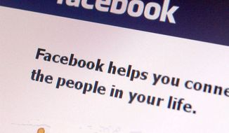 ** FILE ** A Facebook page is seen on a computer.