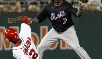Washington Nationals' Roger Bernadina (2) slides safely onto second base as New York Mets shortstop Jose Reyes (7) catches the ball during the seventh inning of a baseball game at Nationals Park, in Washington, on Wednesday, April 27, 2011. Bernadina advaned from first on a throwing error by Mets pitcher R.A. Dickey. The Mets won 6-3. (AP Photo/Jacquelyn Martin)