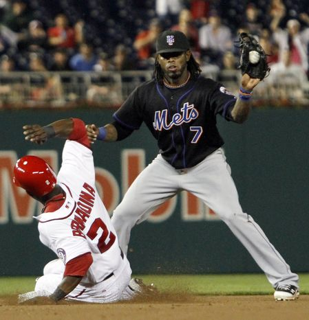 Washington Nationals' Roger Bernadina (2) slides safely onto second base as New York Mets shortstop Jose Reyes (7) catches the ball during the seventh inning of a baseball game at Nationals Park, in Washington, on Wednesday,