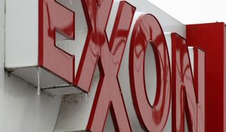 **FILE** An Exxon sign is displayed Jan. 27 atop a minimarket in Carnegie, Pa. (Associated Press)