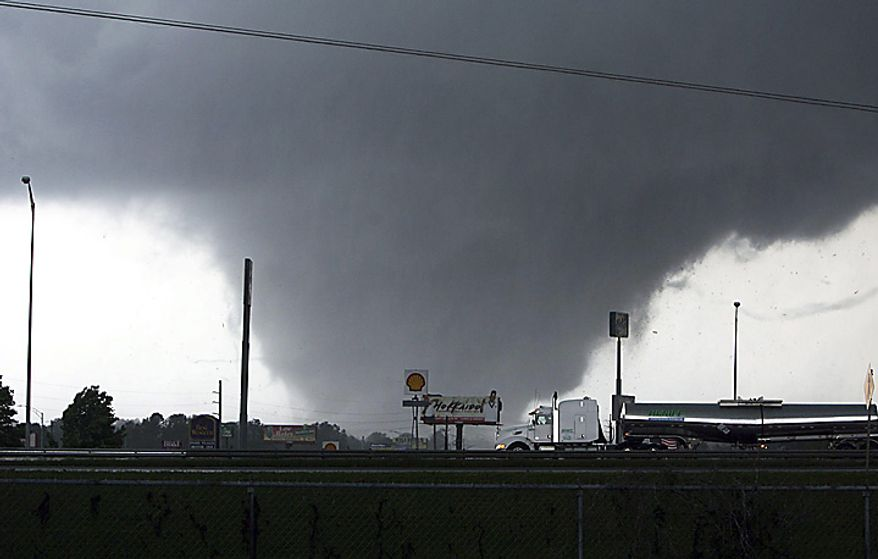 ** FILE ** A tornado moves through Tuscaloosa, Ala. Wednesday, April 27, 2011. (Associated Press)