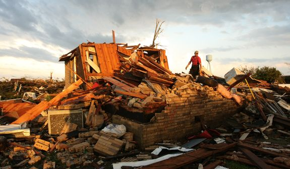 An unidentified emergency responder combs through the wreckage of a destroyed home after a tornado touched down, Wednesday, April 27, 2011 in Smithville, Miss. (AP Photo/The Northeast Mississippi Daily Journal, C. Todd Sherman)