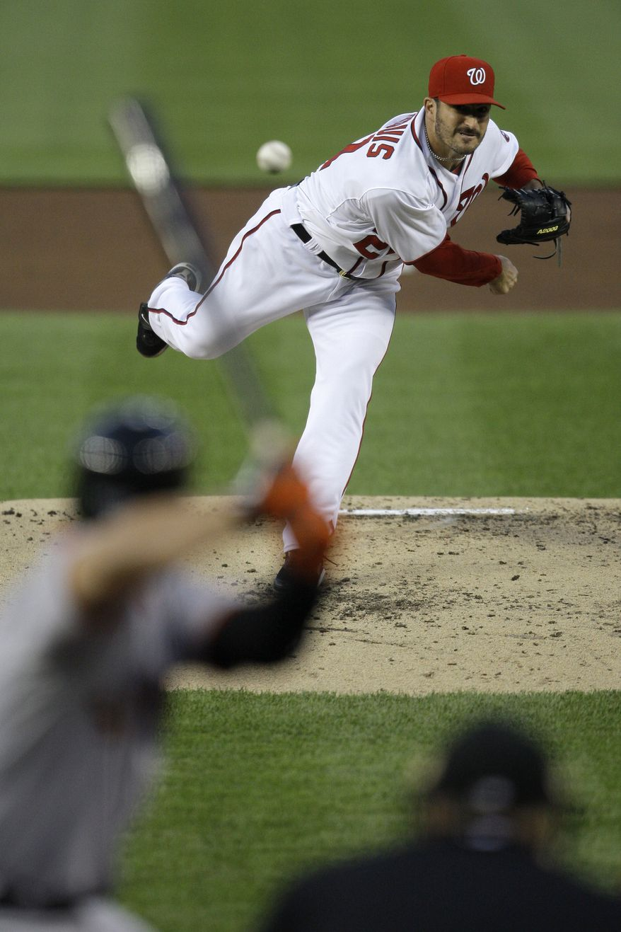 Washington Nationals starting pitcher Jason Marquis (21) throws against the San Francisco Giants during the third inning of a baseball game at Nationals Park, Friday, April 29, 2011, in Washington. (AP Photo/Jacquelyn Martin)