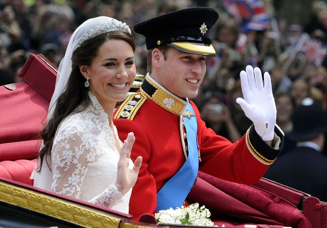 Britain's Prince William and his bride, the former Kate Middleton, now the Duchess of Cambridge, leave Westminster Abbey in London following their wedding on Friday April 29, 2011. (AP Photo/Tom Hevezi)