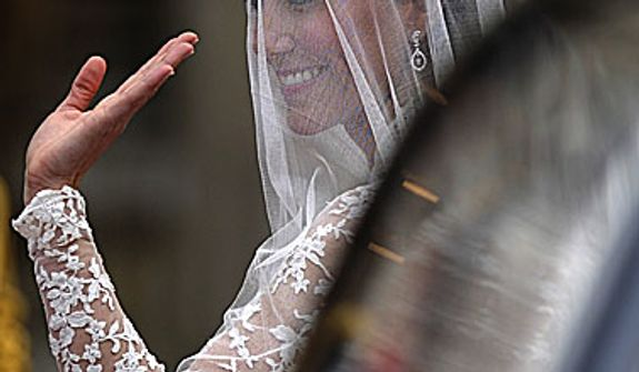 Kate Middleton waves as she arrives at Westminster Abbey at the Royal Wedding with Britain's Prince William in London Friday, April, 29, 2011. (AP Photo/Martin Meissner)