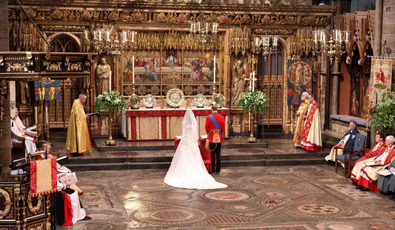 Britain's Prince William, center right, and Kate Middleton, center left, stand at the altar during their wedding service at Westminster Abbey, London, Friday April 29, 2011. (AP Photo/Dominic Lipinski, Pool)