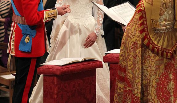 Britain's Prince William and his bride Kate Middleton exchange their vows during the wedding service at Westminster Abbey, London, Friday April 29, 2011. (AP Photo/Dominic Lipinski, Pool)