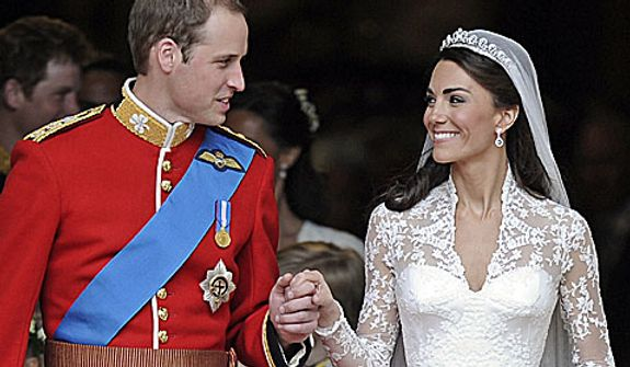 Britain's Prince William and his wife Kate, Duchess of Cambridge stand outside of Westminster Abbey after their Royal Wedding in London Friday, April, 29, 2011. (AP Photo/Martin Meissner)