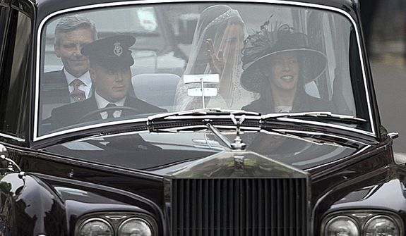 Kate Middleton, back right, makes her way to Westminster Abbey with her father Michael Middleton before the Royal Wedding in London Friday, April, 29, 2011. (AP Photo/Tim Hales)