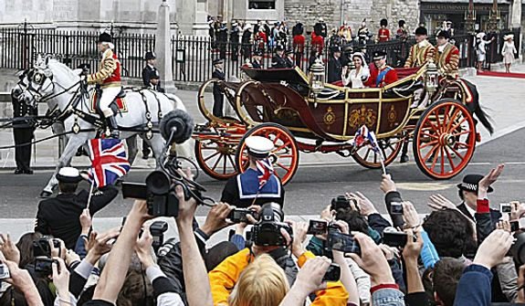 Britain's Prince William and his wife Kate, Duchess of Cambridge, are photographed as they leave Westminster Abbey at the Royal Wedding in London Friday, April 29, 2011. (AP Photo/Alastair Grant)