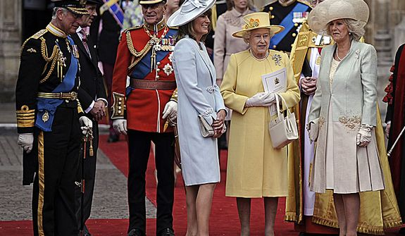 From left, Prince Charles, Prince Phillip, Carole Middleton, Britain's Queen Elizabeth II and Camilla, Duchess of Cornwall stand outside of Westminster Abbey after the Royal Wedding in London Friday, April, 29, 2011. (AP Photo/Martin Meissner)