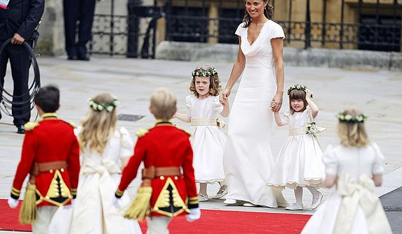 Maid of honour Pippa Middleton arrives with ring bearers Westminster Abbey at the Royal Wedding in London Friday, April 29, 2011. (AP Photo/Alastair Grant)