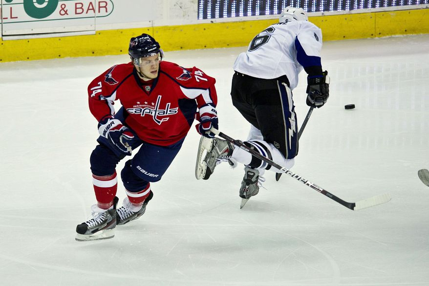 DREW ANGERER/THE WASHINGTON TIMES Capitals rookie defenseman John Carlson (left) departed early with an undisclosed injury in Game 1 against Tampa Bay on Friday, but he was back in action for Game 2 of the Eastern Conference semifinal series.