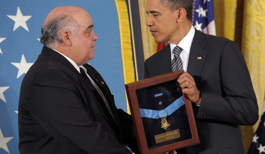 ASSOCIATED PRESS President Obama presents the Medal of Honor to George Kaho'ohanohano, nephew of Korean War casualty Pfc. Anthony T. Kaho'ohanohano, during a posthumous-award ceremony in the East Room of the White House on Monday.