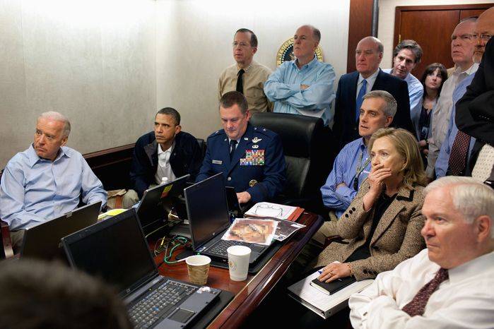 ASSOCIATED PRESS PHOTOGRAPHS In this image released by the White House and digitally altered to obscure the material in front of Secretary of State Hillary Rodham Clinton (right), she, President Obama and Vice President Joseph R. Biden (left), along with members of the national security team, receive an update on the mission against Osama bin Laden in the Situation Room of the White House on Sunday.