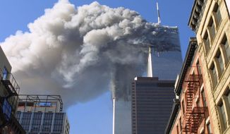 On Sept. 11, 2001, the twin towers of the World Trade Center burn and later collapse after hijacked planes deliberately crashed into them in New York City. A multimillion-dollar reward was offered for now-dead terrorist Osama bin Laden after the attacks.