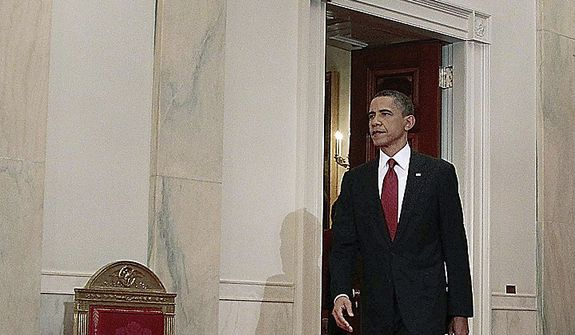 President Barack Obama walks down the Cross Hall on the way to the East Room to make a televised statement on the death of Osama bin Laden from the White House in Washington, Sunday, May 1, 2011.  (AP Photo/Pablo Martinez Monsivais)