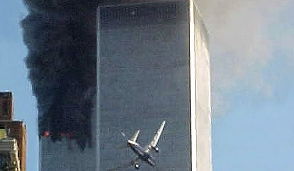 In this Sept. 11, 2001 file photo, a jet airliner is lined up on one of the World Trade Center towers in New York. A person familiar with developments said Sunday, May 1, 2011 that Osama bin Laden is dead and the U.S. has the body. (AP Photo/Carmen Taylor, File)