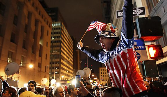 A large, jubilant crowd reacts to the news of Osama Bin Laden's death at the corner of Church and Vesey Streets, adjacent to ground zero, during the early morning hours of Tuesday, May 2, 2011 in New York. President Barack Obama announced Sunday night, May 1, 2011, that Osama bin Laden was killed in an operation led by the United States.  (AP Photo/Jason DeCrow)
