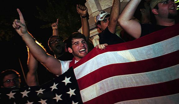 University of Georgia students wave flags as they celebrate the death of Osama bin Laden in front of a Civil War Memorial on the morning of Monday May 2, 2011 in Athens, Ga. (AP Photo/Athens Banner-Herald, David Manning)