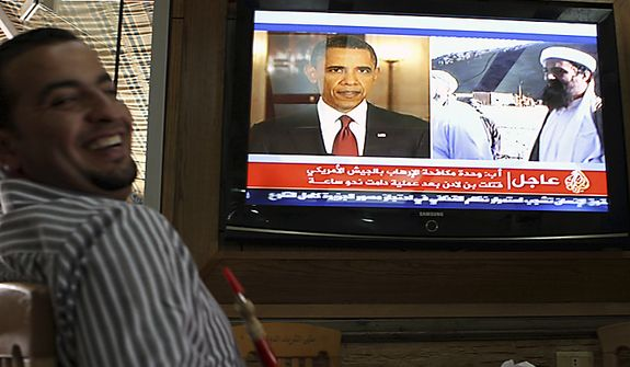 "A Jordanian man reacts as he watch a TV news report about the killing of Osama bin Laden at a coffeshop in Amman, Jordan, Monday, May 2, 2011. Bin Laden, the glowering mastermind behind the Sept. 11, 2001, terror attacks that killed thousands of people was slain in his luxury hideout in Pakistan early Monday in a firefight with U.S. forces, ending a manhunt that spanned a frustrating decade. Arabic writing in screen bottom reads "" Counter-terrorism unit in US Army killed Bin Laden after one hour operation"".  (AP Photo/ Nader Daoud)"