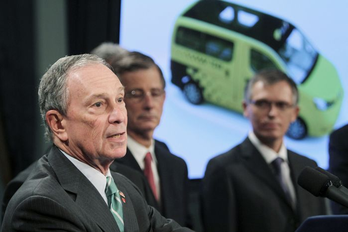 ASSOCIATED PRESS New York City Mayor Michael R. Bloomberg (left) is joined Tuesday by Carlos Tavares (right), chairman of Nissan Motor Co.'s Americas operation, as he announces the winner of the the city's Taxi of Tomorrow competition, Nissan's NV 200.