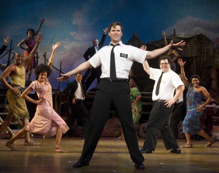 """Andrew Rannells (center) performs with the cast of """"The Book of Mormon,"""" which nabbed a leading 14 Tony Award nominations Tuesday morning, earning the profane musical nods for best musical, best book of a musical, best original score, two leading-actor spots and two featured-actor nominations. (AP Photo/Boneau/Bryan-Brown, Joan Marcus)"""