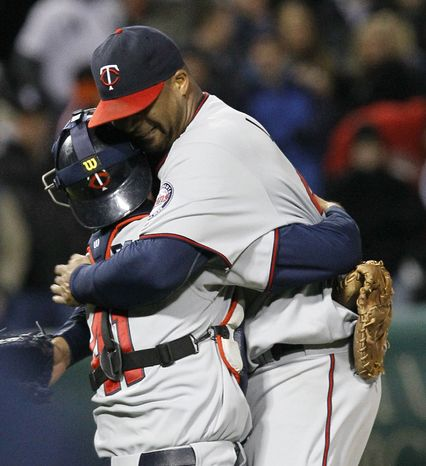 Minnesota Twins starting pitcher Francisco Liriano, right, celebrates with catcher Drew Butera after his no-hitter and 1-0 win over Chicago Whi