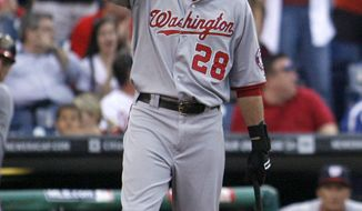 Washington Nationals' Jayson Werth tips his cap to the crowd in the first inning of a baseball game against the Philadelphia Phillies on Tuesday, May 3, 2011, in Philadelphia. Werth was playing his first game in Philadelphia since signing with the Nationals. The Phillies won 4-1. (AP Photo/H. Rumph Jr)