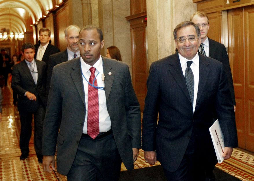 CIA Director Leon E. Panetta (right) leaves Capitol Hill in Washington on Tuesday, May 3, 2011, after briefing members of Congress on the raid on Osama bin Laden's compound in Pakistan. (AP Photo/Alex Brandon)