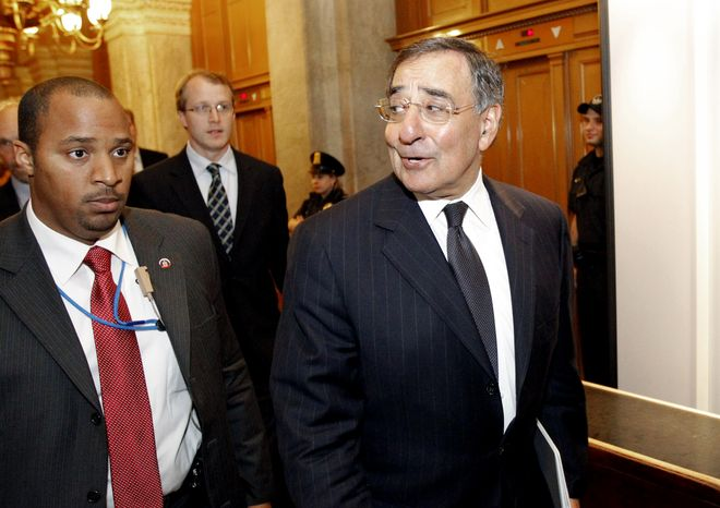 CIA Director Leon E. Panetta (right) leaves the Capitol in Washington on Tuesday, May 3, 2011, after briefing members of Congress on the raid on Osama bin Laden's compound in Pakistan. (AP Photo/Alex Brandon)