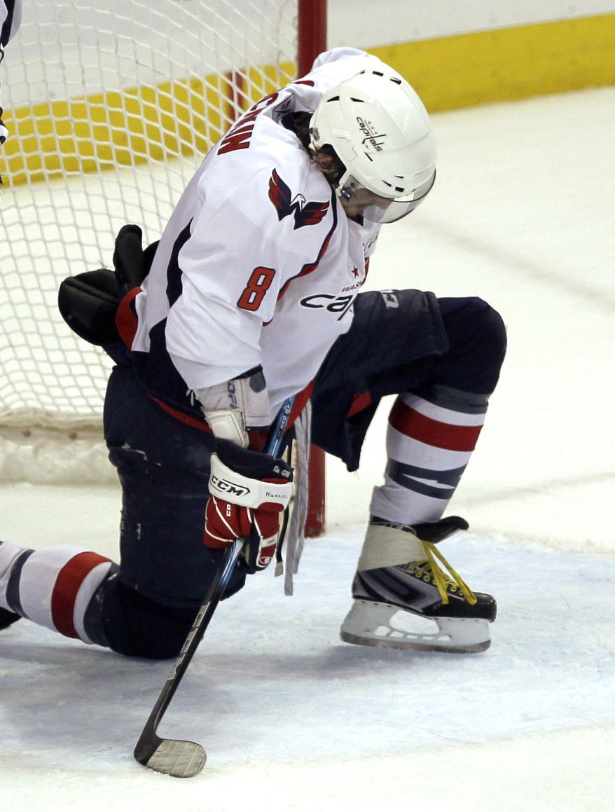 Washington Capitals' Alex Ovechkin, of Russia, pauses before getting up after running into the goal while attempting a shot against the Tampa Bay Lightning late in the third period in Game 4 of an NHL hockey Stanley Cup playoff Eastern Conference semifinal series in Tampa, Fla., Wednesday, May 4, 2011. Tampa Bay won 5-3, and swept the series. (AP Photo/John Raoux)