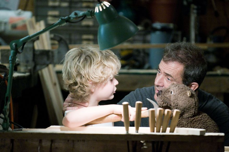 """ASSOCIATED PRESS Riley Thomas Stewart plays Mel Gibson's son in """"The Beaver,"""" the story of a man battling depression who finds that communicating via a puppet is a way to reconnect with his wife and two children. The film was directed by Jodie Foster, who also plays Mr. Gibson's character's wife."""