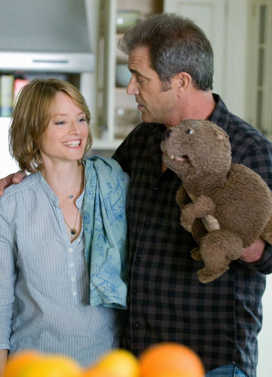 "SUMMIT ENTERTAINMENT VIA ASSOCIATED PRESS Jodie Foster and Mel Gibson consult during the filming of ""The Beaver."""