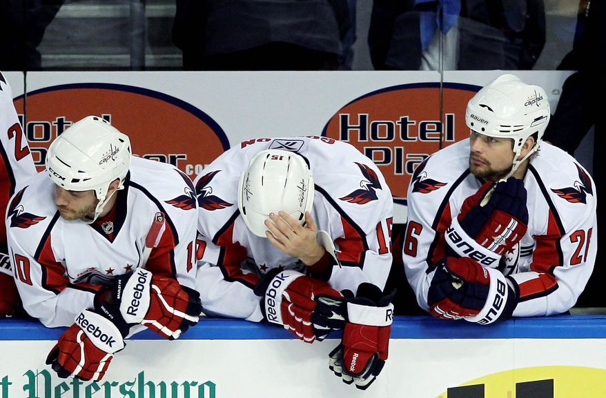 ASSOCIATED PRESS Washington Capitals (from left) Matt Bradley, Boyd Gordon and Matt Hendricks wait out the final moments of their season in Wednesday night's 5-3 loss to Tampa Bay. The Lightning swept the Capitals in four games in their Eastern Conference semifinal series.