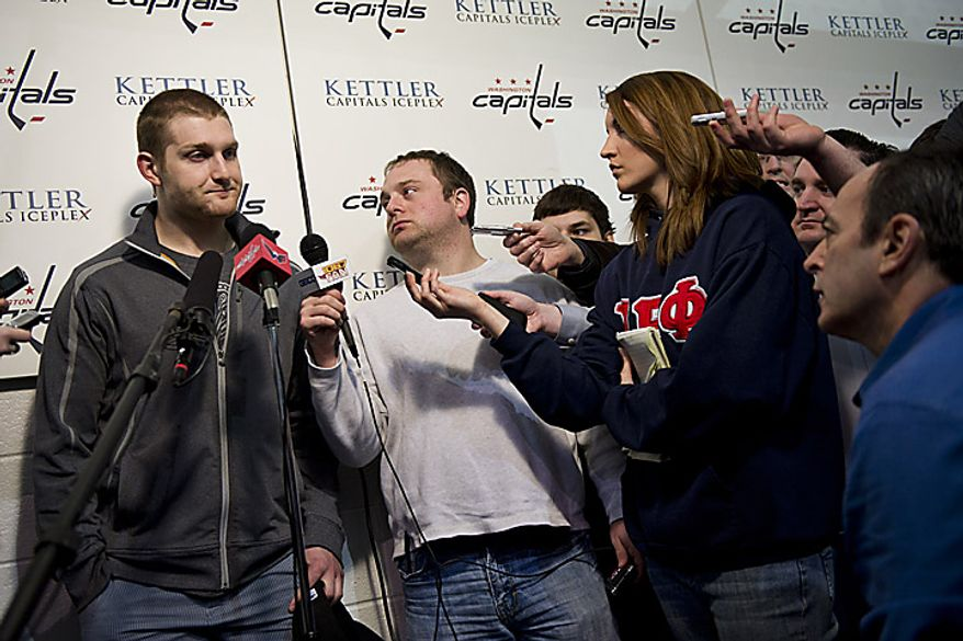 Capitals player Carl Alzner talks with the media at the Kettler Ice Complex in Arlington on Thursday, May 5, 2011. (Drew Angerer/The Washington Times)