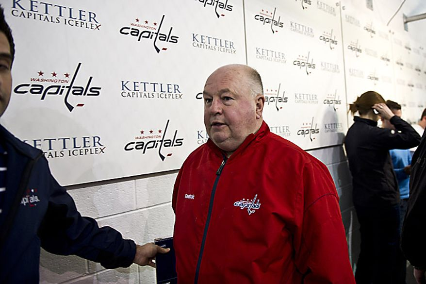 Capitals coach Bruce Boudreau returns to the locker room after talking with the media at the Kettler Ice Complex in Arlington on Thursday, May 5, 2011. (Drew Angerer/The Washington Times)