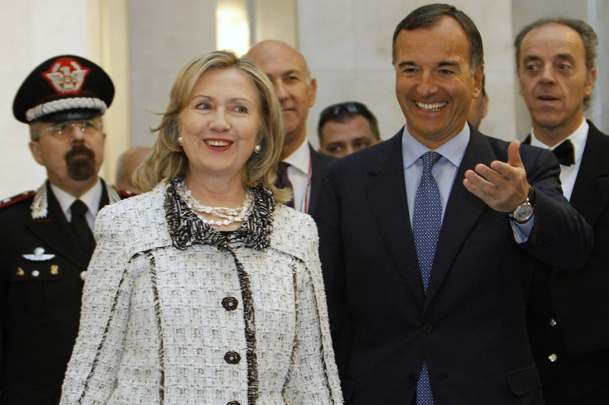 Italian Foreign Minister Franco Frattini (right) welcomes U.S. Secretary of State Hillary Rodham Clinton at the Ministry of Foreign Affairs in Rome during the second meeting of the Contact Group on Libya on Thursday, May 5, 2011. (AP Photo/Jacquelyn Martin, Pool)