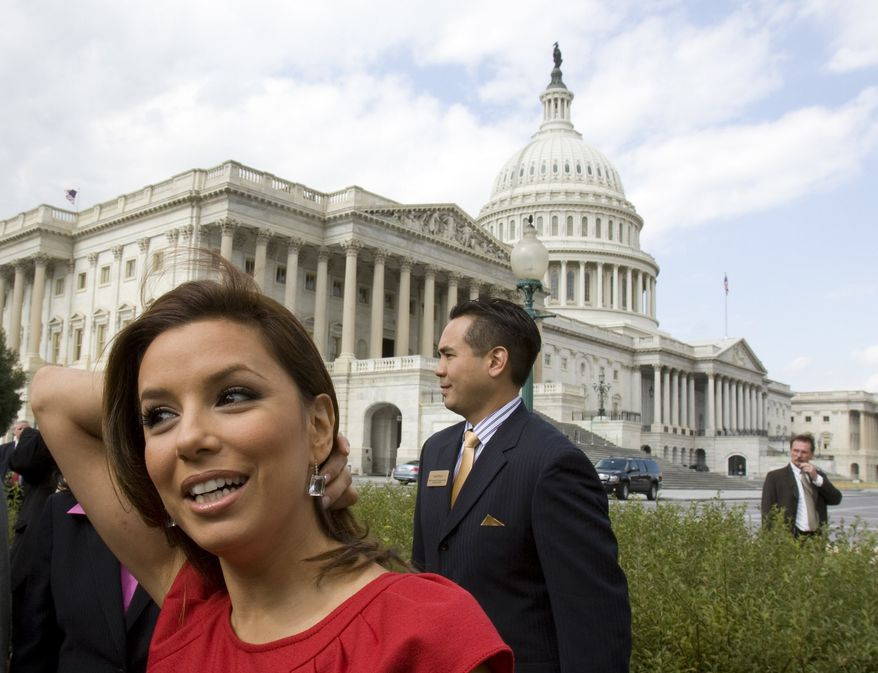 ** FILE ** In this Oct. 13, 2009, file photo, actress Eva Longoria is seen on Capitol Hill in Washington, during an event announcing the leadership of the National Museum of the American Latino Commission. (AP Photo/Harry Hamburg, File)