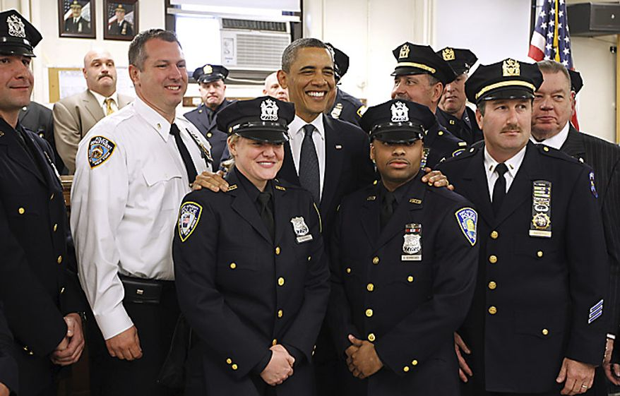 President Barack Obama meets with police officers and first responders at the First Precinct before visiting the National Sept. 11 Memorial at Ground Zero in New York, Thursday, May 5, 2011. (AP Photo/Charles Dharapak)