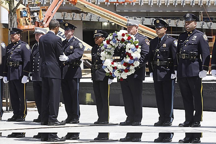 President Barack Obama arrives to lay a wreath at the National Sept. 11 Memorial at Ground Zero in New York, Thursday, May 5, 2011. (AP Photo/Charles Dharapak)