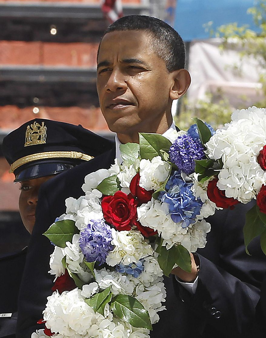 President Barack Obama lays a wreath at the National Sept. 11 Memorial at Ground Zero in New York, Thursday, May 5, 2011. (AP Photo/Charles Dharapak)