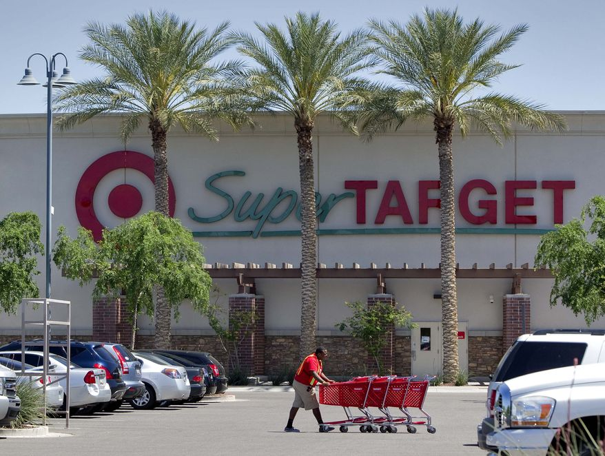 A Target employee retrieves shopping carts outside a company store in Gilbert, Ariz., on Tuesday, April 5, 2011. Retailers are reporting strong April sales that were helped by a late Easter, capping off a solid spring season. (AP Photo/Matt York)
