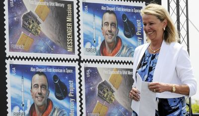 Julie Jenkins, one of the late astronaut Alan Shepard's daughters, attends the dedication ceremony for the Mercury Project/Messenger Mission stamp on Wednesday, May 4, 2011, at Kennedy Space Center Visitor Complex in Florida. The Postal Service dedicated the stamp to mark the 50th anniversary of Shepard's suborbital flight, Freedom 7. (AP Photo/Florida Today, Michael R. Brown)